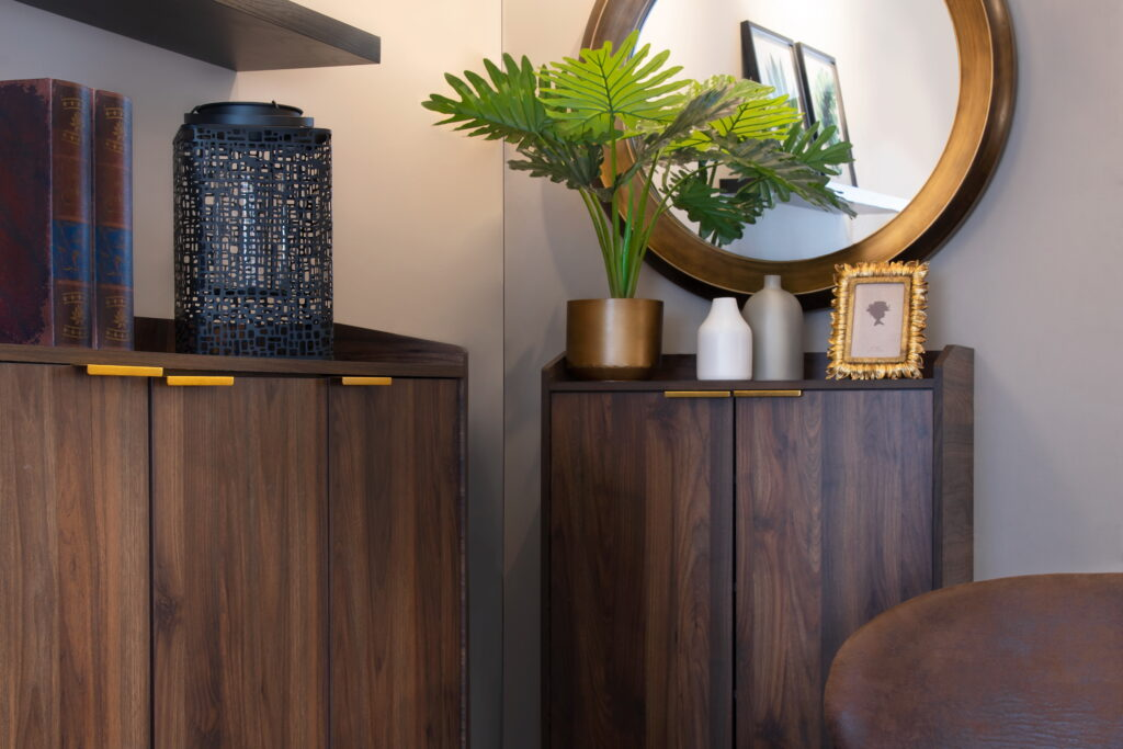 Wooden sideboards with gold accents styled in modern design style.