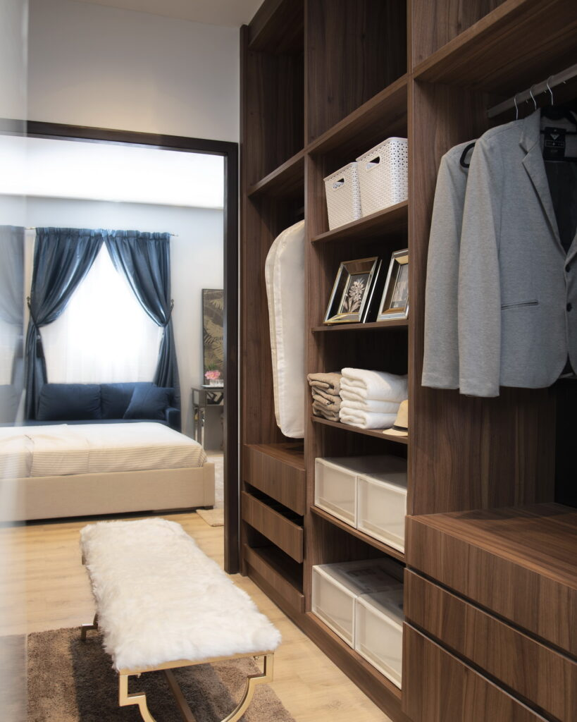Walk-in wardrobe with plenty of storage options.