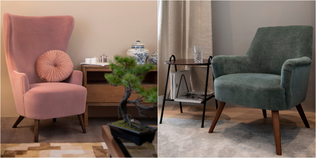 Earth tones in armchairs, dusty pink and moss green with wooden legs.