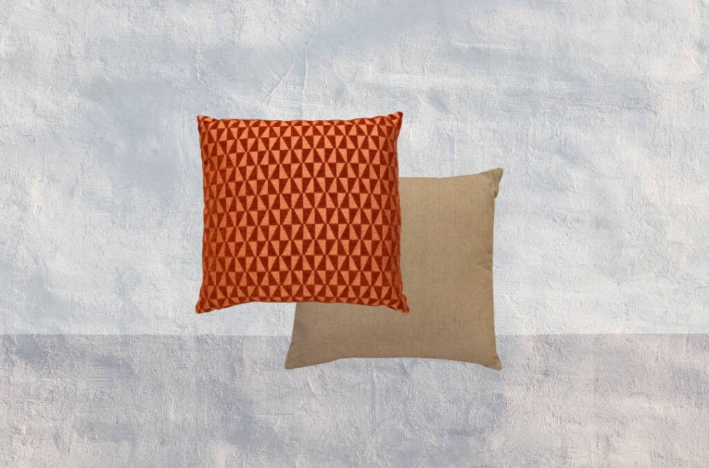 Red and orange patterned throw pillow and brown textured throw pillow.