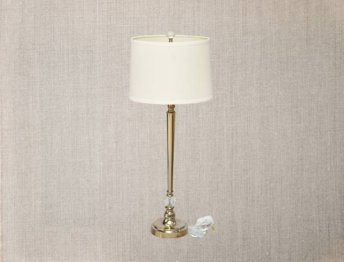 Classical lamp with golden stand and white lampshade.